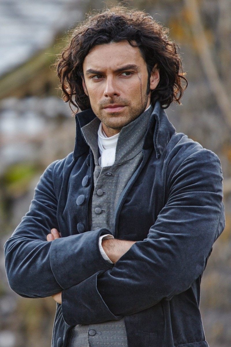 Embracing dramatic tailoring, Ross Poldark (Aidan Turner) wears men's separates with strong necklines.