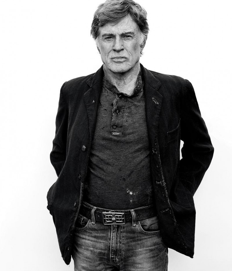 Robert Redford rocks a sports jacket over a henley and denim jeans.