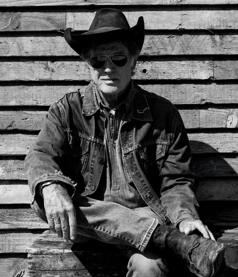 Robert Redford wears a cowboy hat and denim.