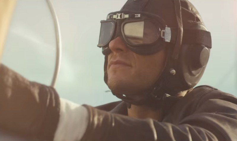 Scott Eastwood goes the pilot route in a brown leather jacket and aviator cap.