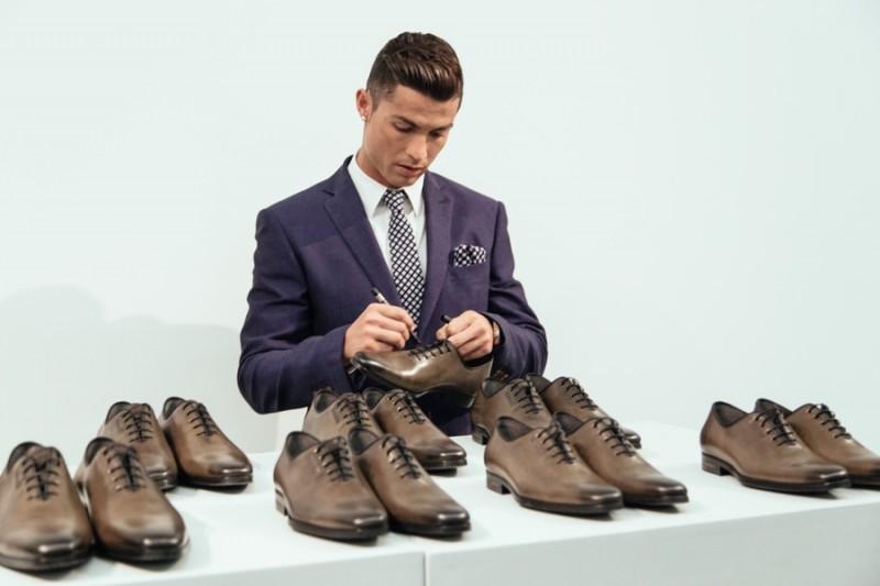 Cristiano Ronaldo autographs shoes.