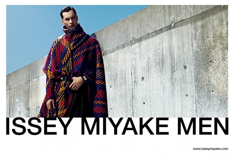 Model Dima Dionesov makes quite the printed impression as he stars in Issey Miyake's fall-winter 2015 campaign. The Sight Management model is front and center in a graphic update on tartan.