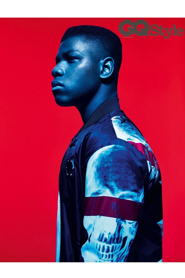 John Boyega wears t-shirt Sunspel and skull bomber jacket Philipp Plein.