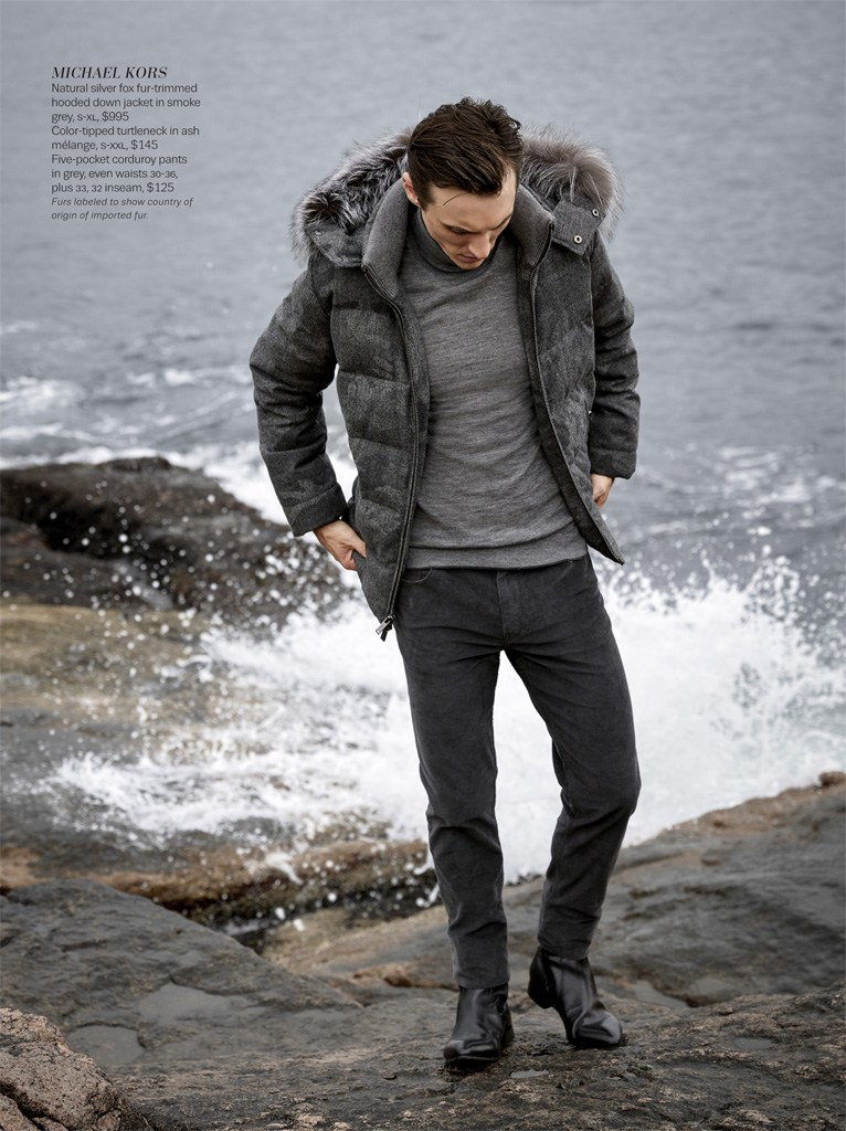 Going luxe, Thomas Gibbons rocks a Michael Kors' silver fox fur-trimmed hooded parka down jacket.