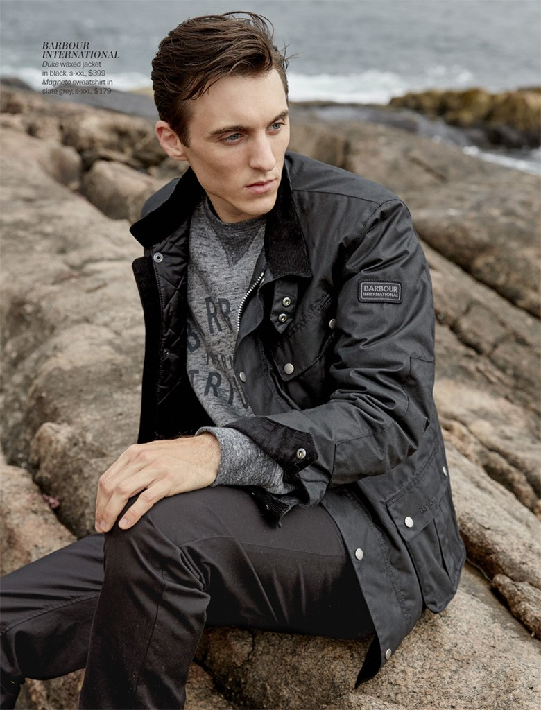 Thomas Gibbons dons a waxed Barbour International jacket.