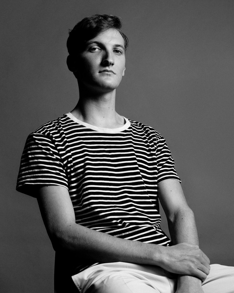 Connor wears t-shirt YMC and trousers Zara.