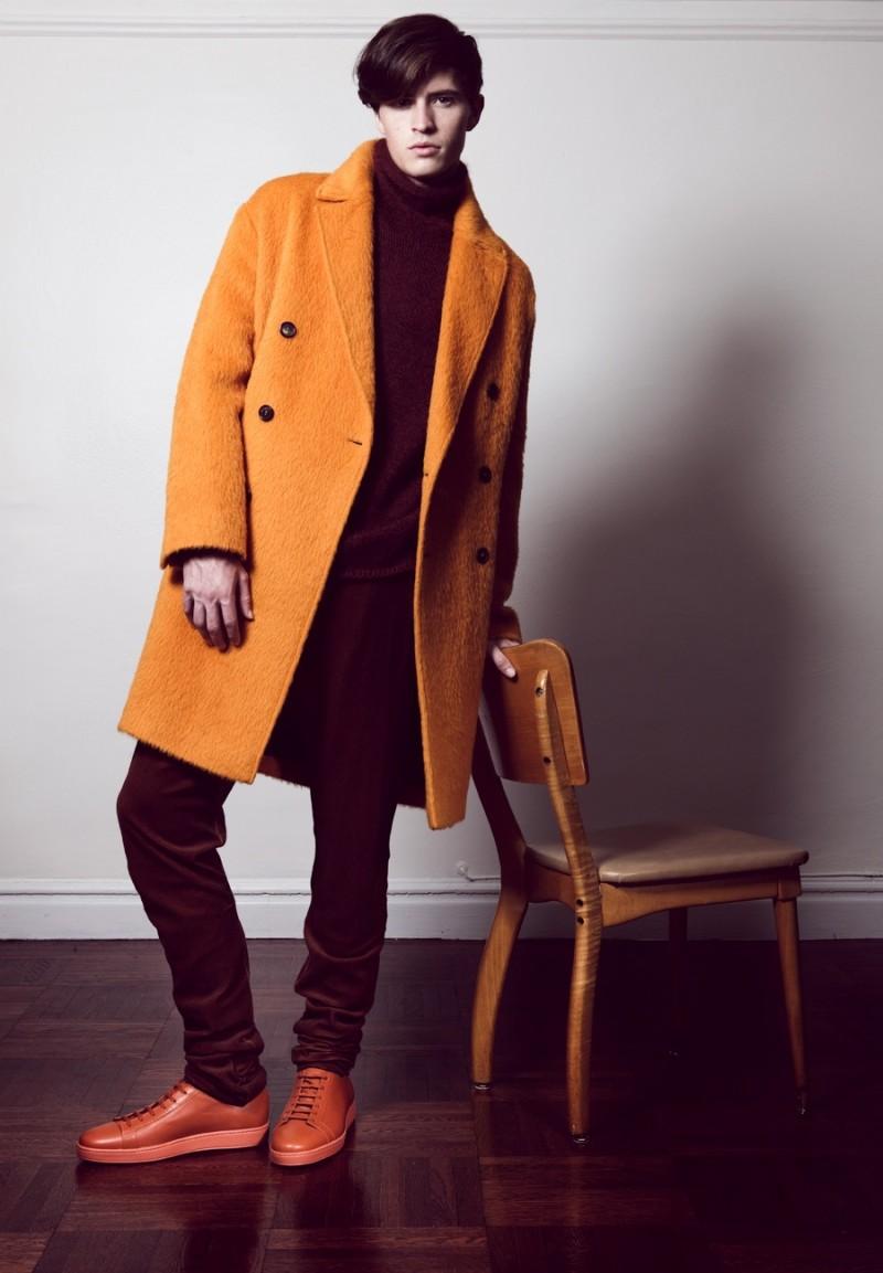 Taylor wears coat AMI, sweater Pal Zileri, pants Bottega Veneta and shoes Santoni.