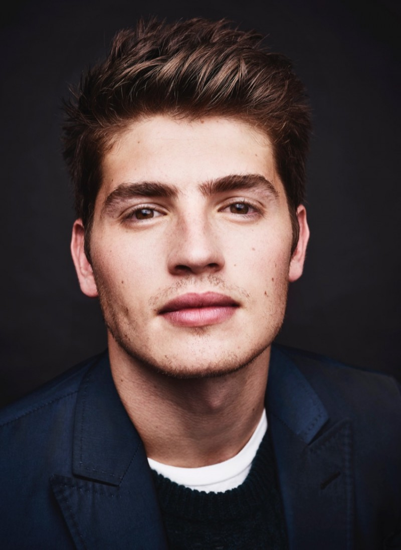 Gregg Sulkin wears suit Valentino, t-shirt Acne Studios and pullover Burberry.