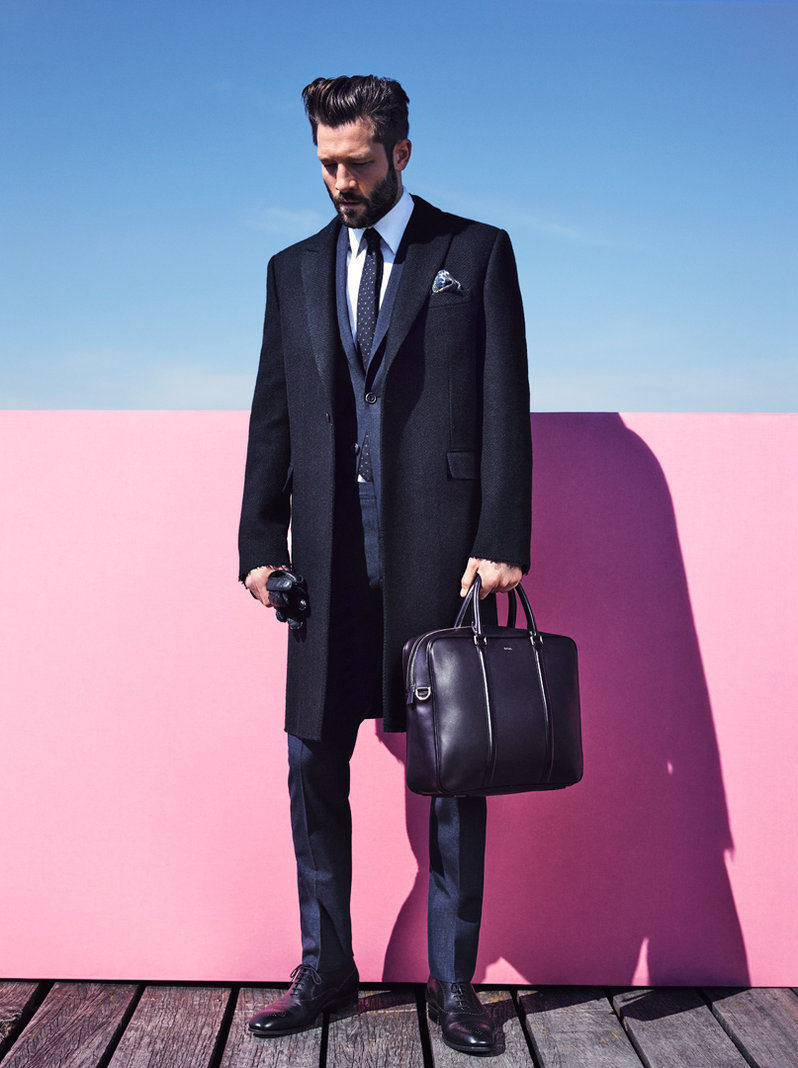 John cleans up in a sleek tailored coat and suit for GQ France's Style Manuel.