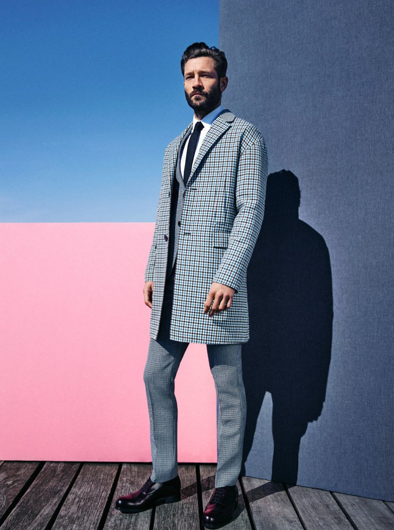 John embraces modern tailoring with a slim silhouette.