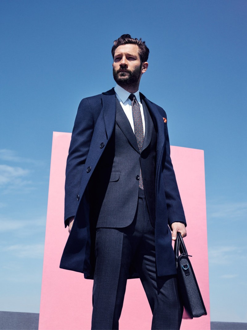 John goes professional in a tailored suit and coat number.
