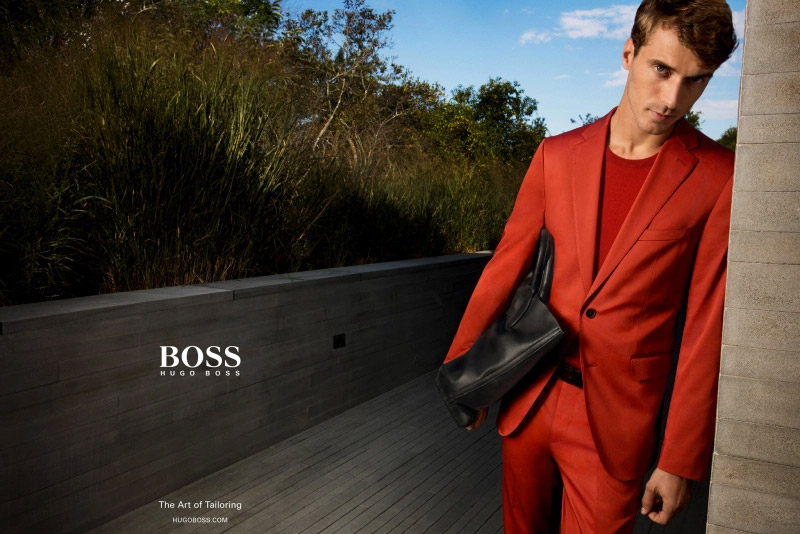 Clément Chabernaud dons a striking red suit for BOSS by Hugo Boss' spring-summer 2016 menswear campaign.