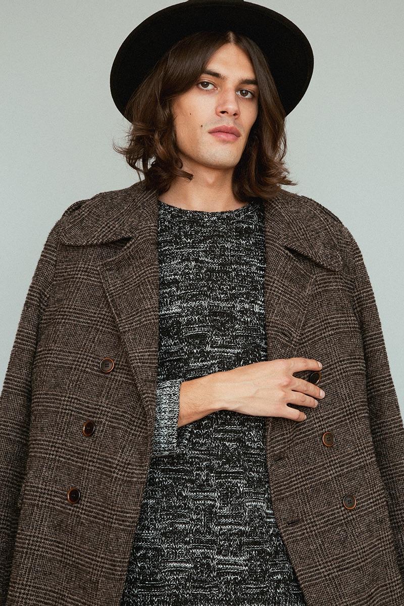 Álvaro wears coat Trussardi, sweater Religion and hat BKMTC.