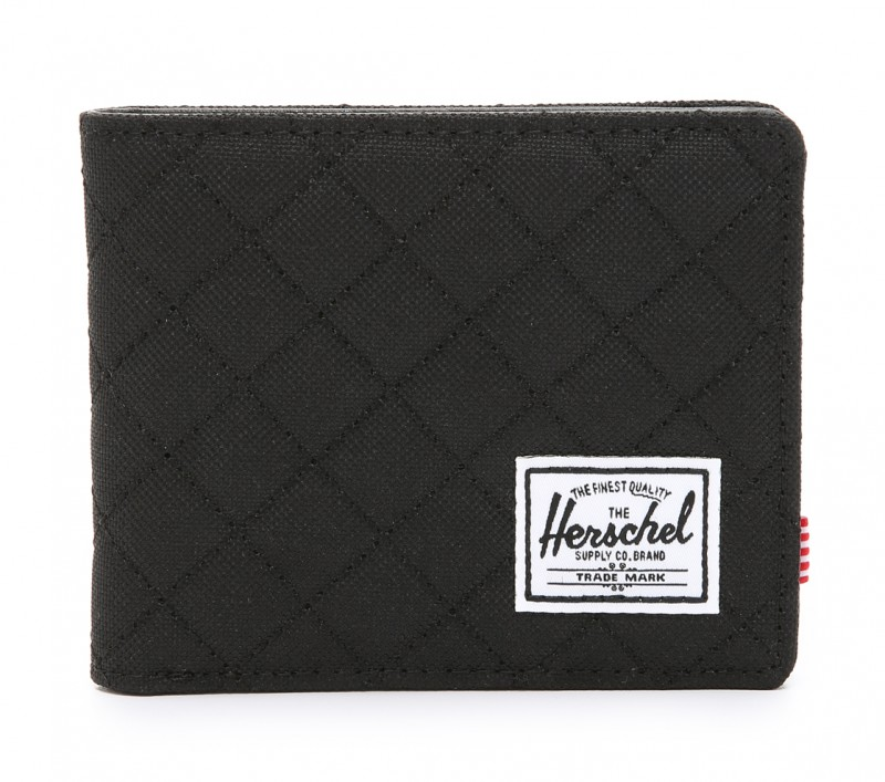 """Herschel Supply Co. Hank Quilted Bifold Wallet $35: """"A slim Herschel Supply Co. wallet, in quilted nylon with a front brand patch. Leather interior with 3 card slots, an ID window, and a lined cash compartment."""""""