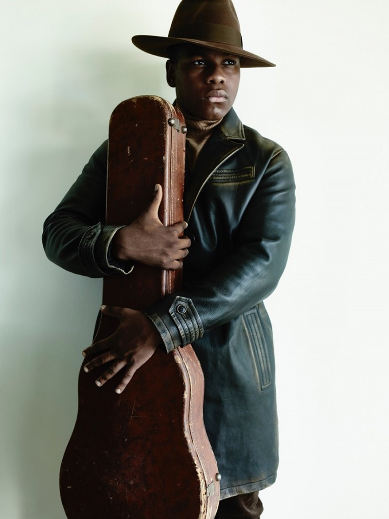 Clutching on to a guitar case, John Boyega is photographed for British GQ.
