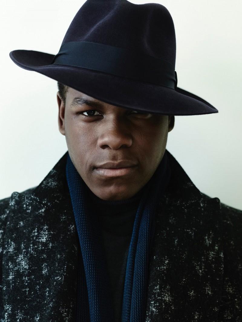 John Boyega photographed by Bryan Adams in a chic felt fedora hat.