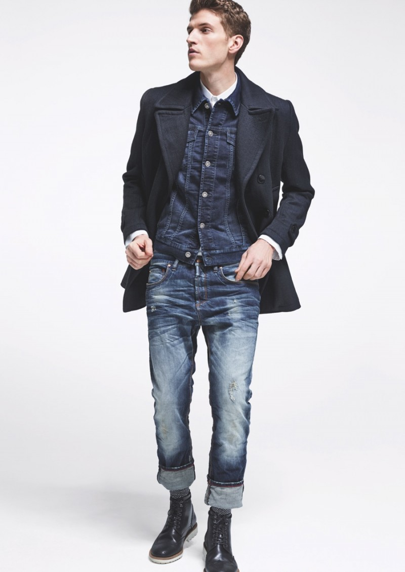 Andre wears a distressed denim look from MAC Jeans.