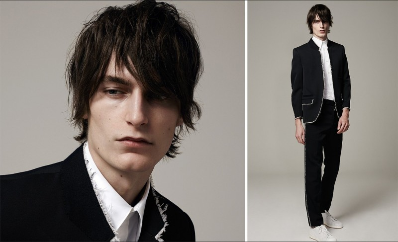 Stand-collar raw-edge blazer, harness short-sleeved cotton-blend shirt, raw-edge tailored trousers and quilted low-top leather trainers, all by Alexander McQueen.