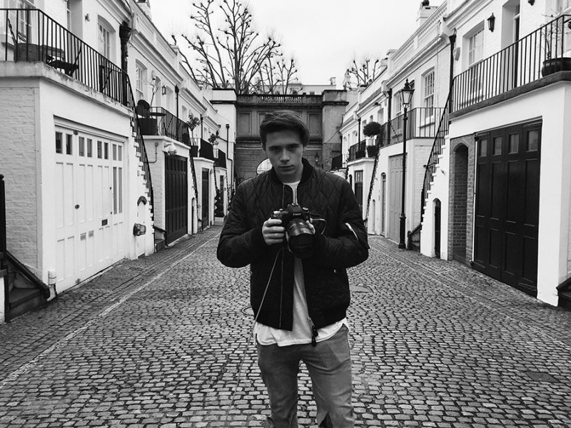 Brooklyn Beckham poses for a picture as Burberry's latest photographer.