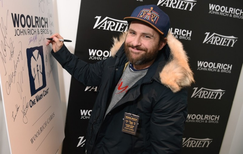 Charlie Day poses for a photo in Woolrich John Rich & Bros. at the 2016 Sundance Film Festival.