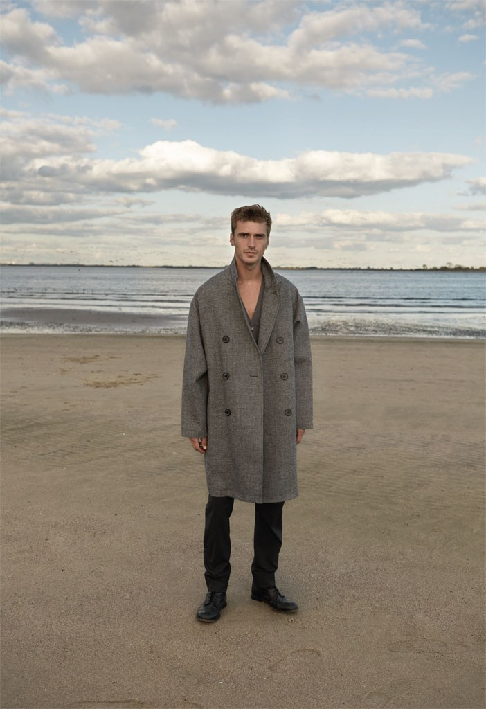 Clément Chabernaud is captured on the beach in an oversized winter coat.