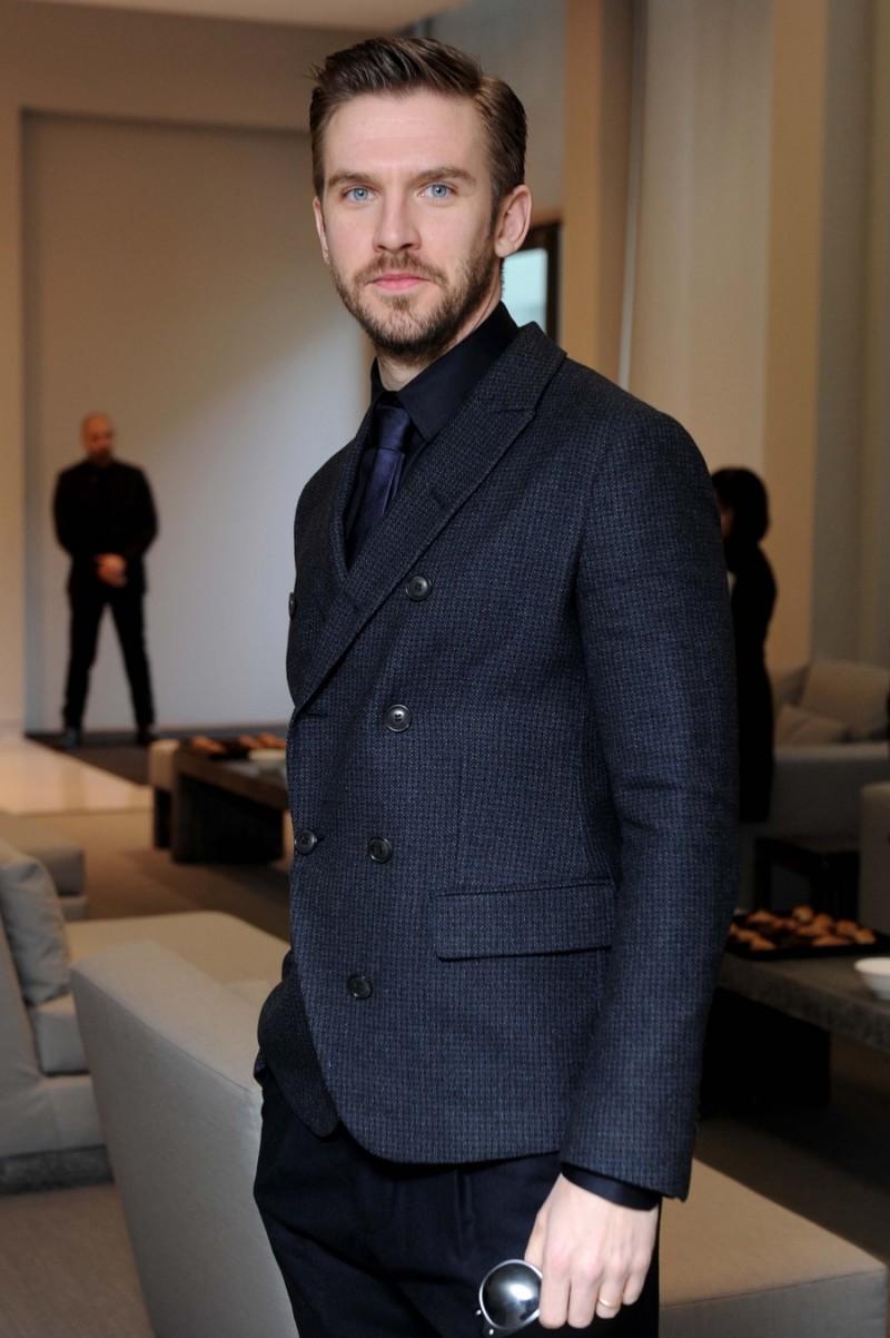 7865e18295169 Dan Stevens suits up for Giorgio Armani s fall-winter 2016 men s show.