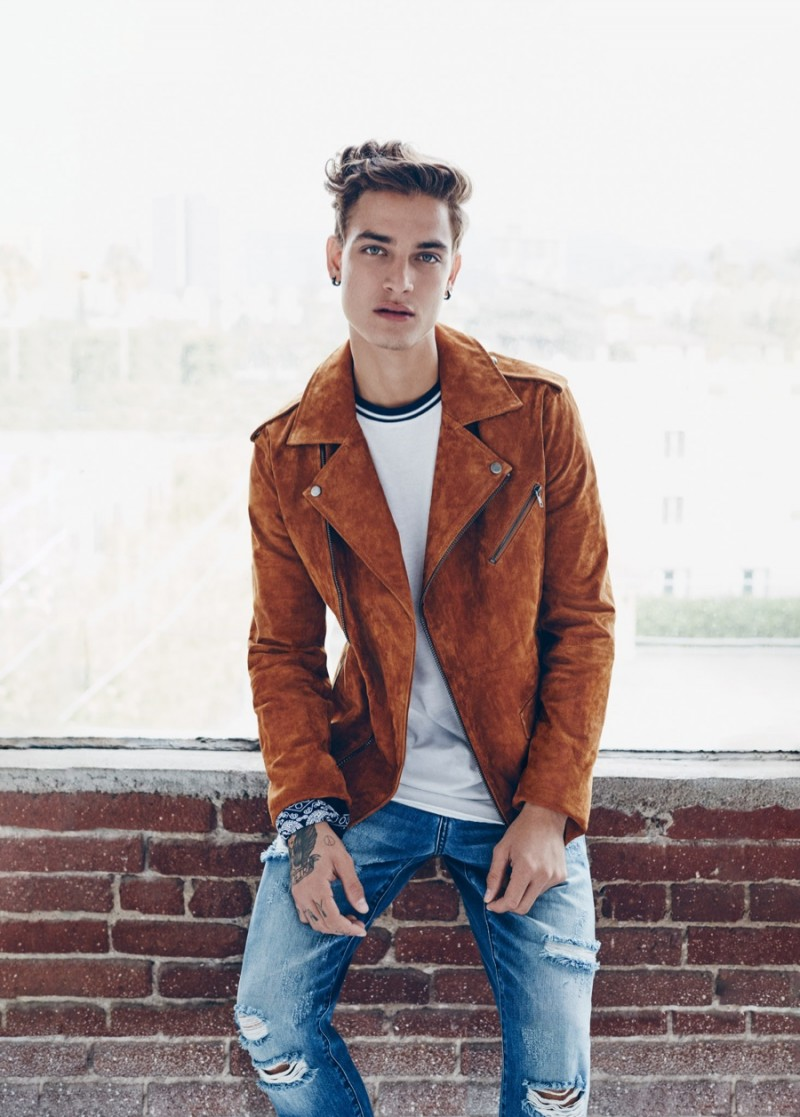 Brazilian model Jonathan Bellini dons a brown biker jacket and ripped distressed denim jeans for Forever 21's spring 2016 campaign.