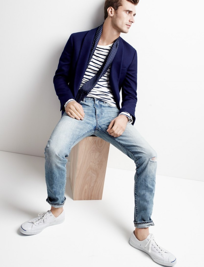Clément Chabernaud wears Ludlow Shawl-Collar Dinner Jacket in Fiore Cotton, Long-Sleeve Deck Stripe T-Shirt, 484 Jeans in Tobias Wash, Converse Jack Purcell Signature Sneakers and Silk Dotted Scarf, all from J.Crew.