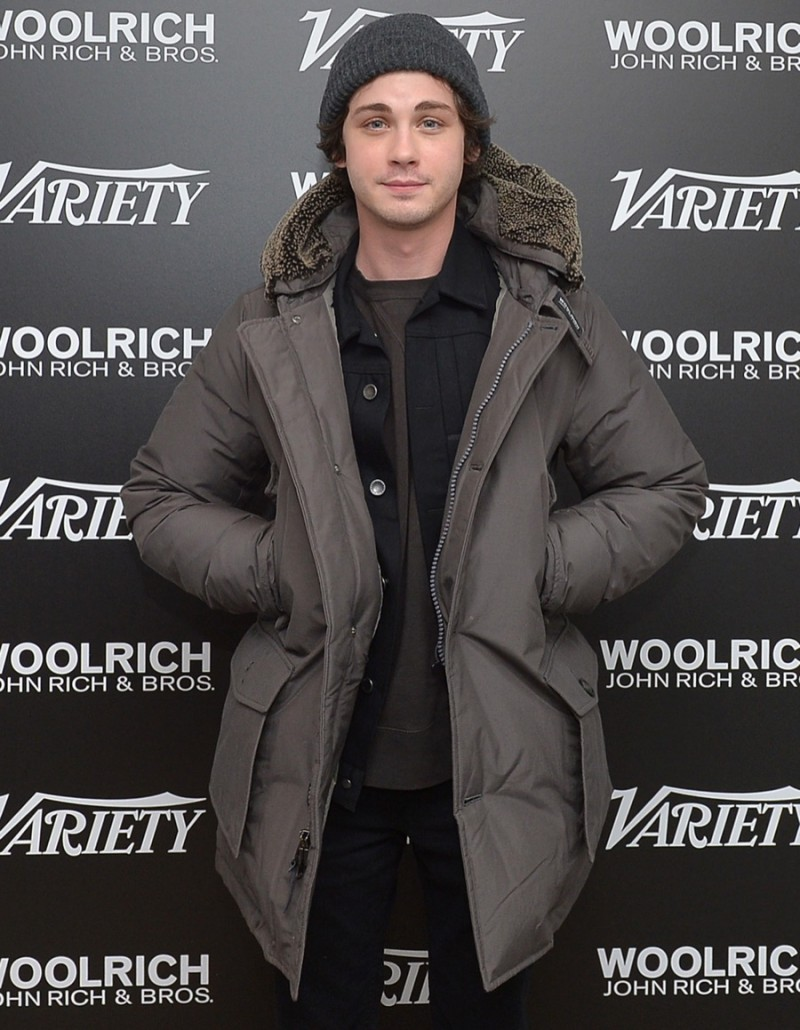 Logan Lerman poses for a photo in Woolrich John Rich & Bros. at the 2016 Sundance Film Festival.