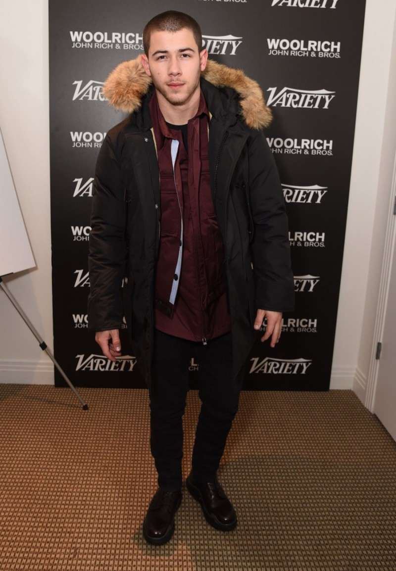 Nick Jonas poses for a photo in Woolrich John Rich & Bros. at the 2016 Sundance Film Festival.