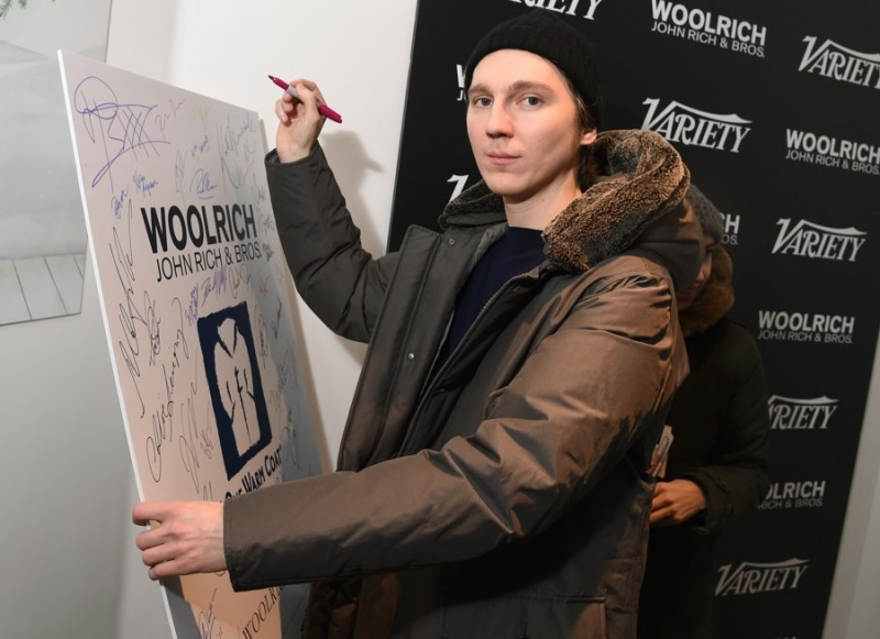 Paul Dano poses for a photo in Woolrich John Rich & Bros. at the 2016 Sundance Film Festival.
