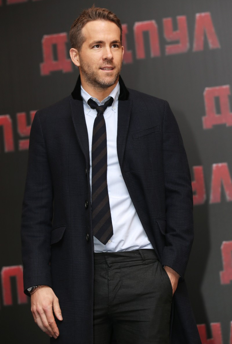 Attending a Deadpool press conference in Moscow, Russia, Ryan Reynolds embraced a smart look in tailored separates, a clean dress shirt and striped tie.