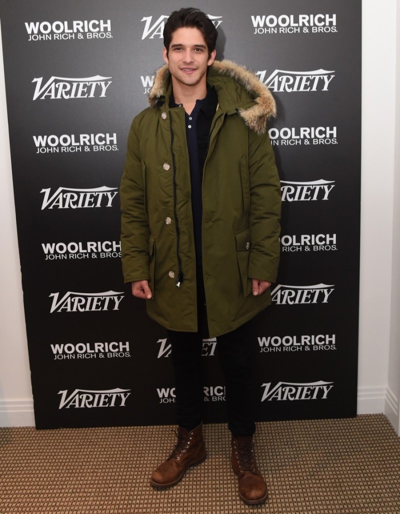 Tyler Posey poses for a photo in Woolrich John Rich & Bros. at the 2016 Sundance Film Festival.