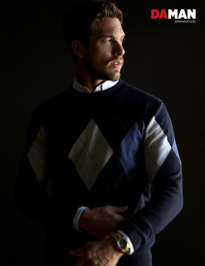 Adam Senn embraces argyle with a spring sweater from Dior Homme.
