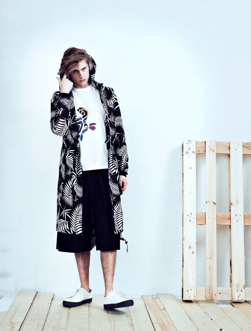 Neels wears t-shirt Jil Sander, parka Control Sector, shorts McQ Alexander McQueen and sneakers Vince.