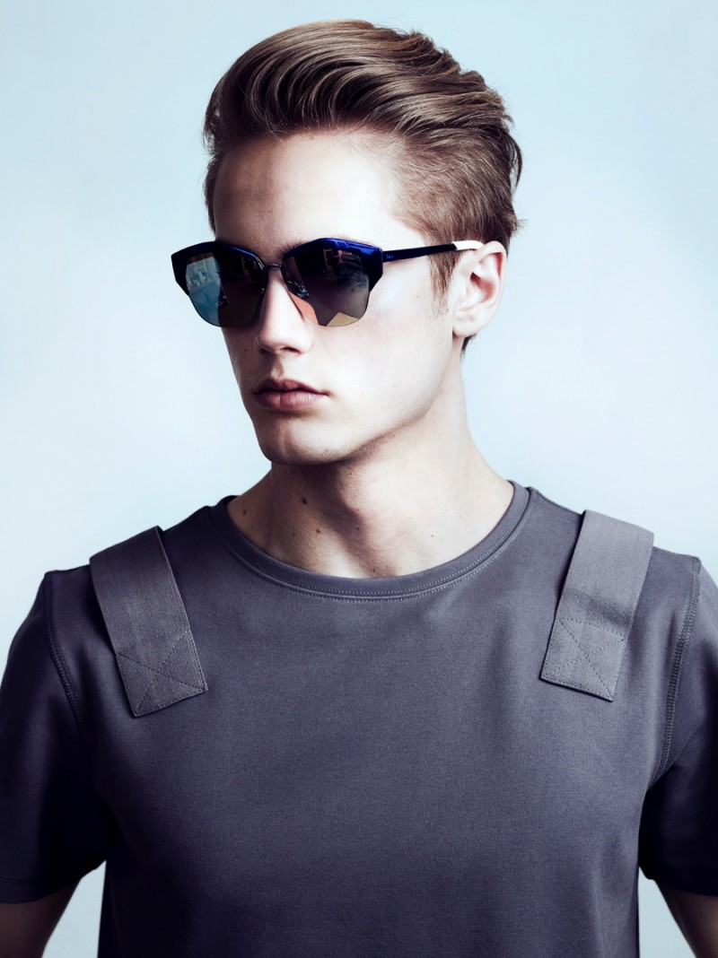 Neels wears t-shirt Control Sector and sunglasses Dior.