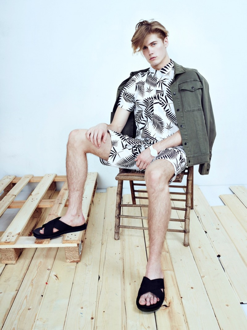 Neels wears jacket Michael Stars, watch stylist's own, sandals Vince, palm tree print shirt and shorts Control Sector.