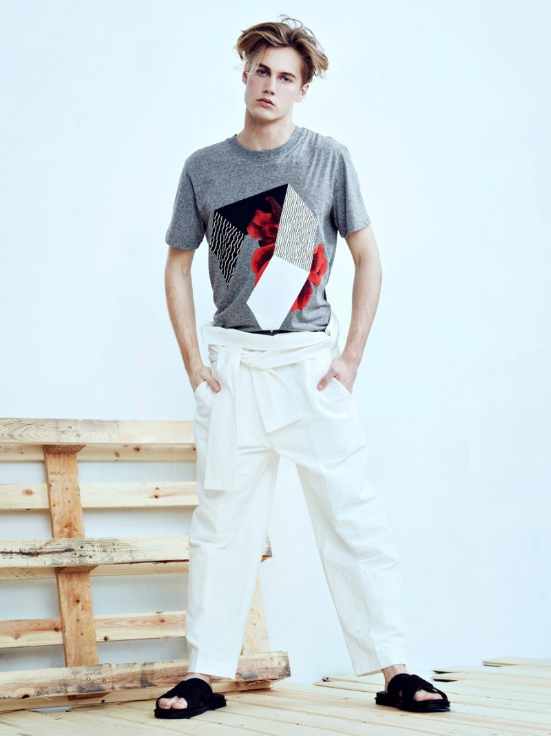 Neels wears graphic t-shirt McQ Alexander McQueen, pants 3.1 Phillip Lim and sandals Vince.