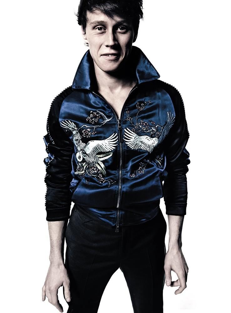George Mackay sports one of Louis Vuitton's trendy silk bomber jackets for L'Uomo Vogue.