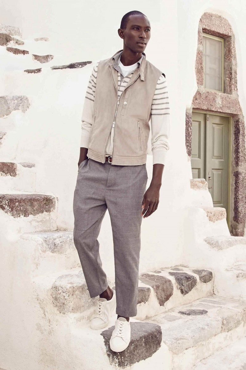 Wearing spring neutrals for Holt Renfrew, Armando Cabral is photographed in a look from Brunello Cucinelli.