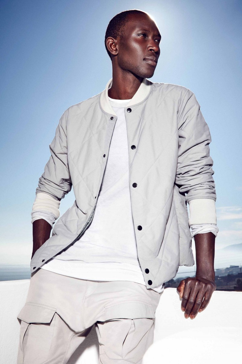 Armando Cabral relaxes in greys from Rag & Bone.