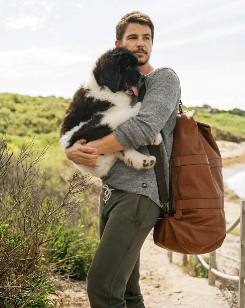 Photographed by Bruce Weber, Josh Hartnett poses with a dog for Marc O 'Polo's