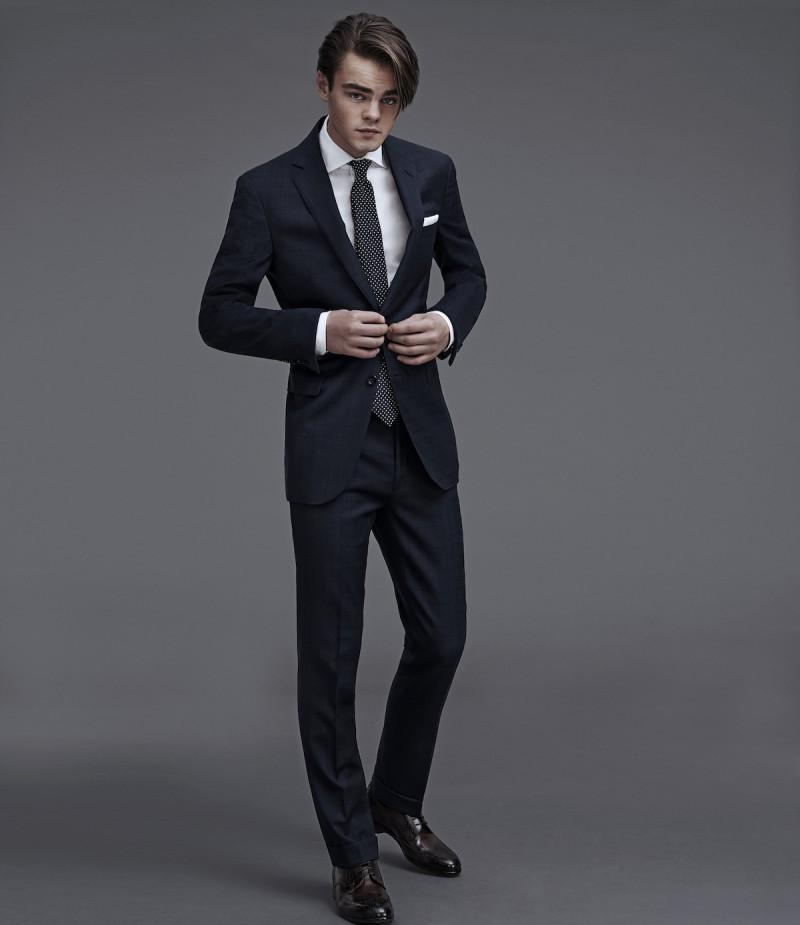 Konrad Annerud cuts a sharp figure in a tailored Ralph Lauren Purple Label suit.