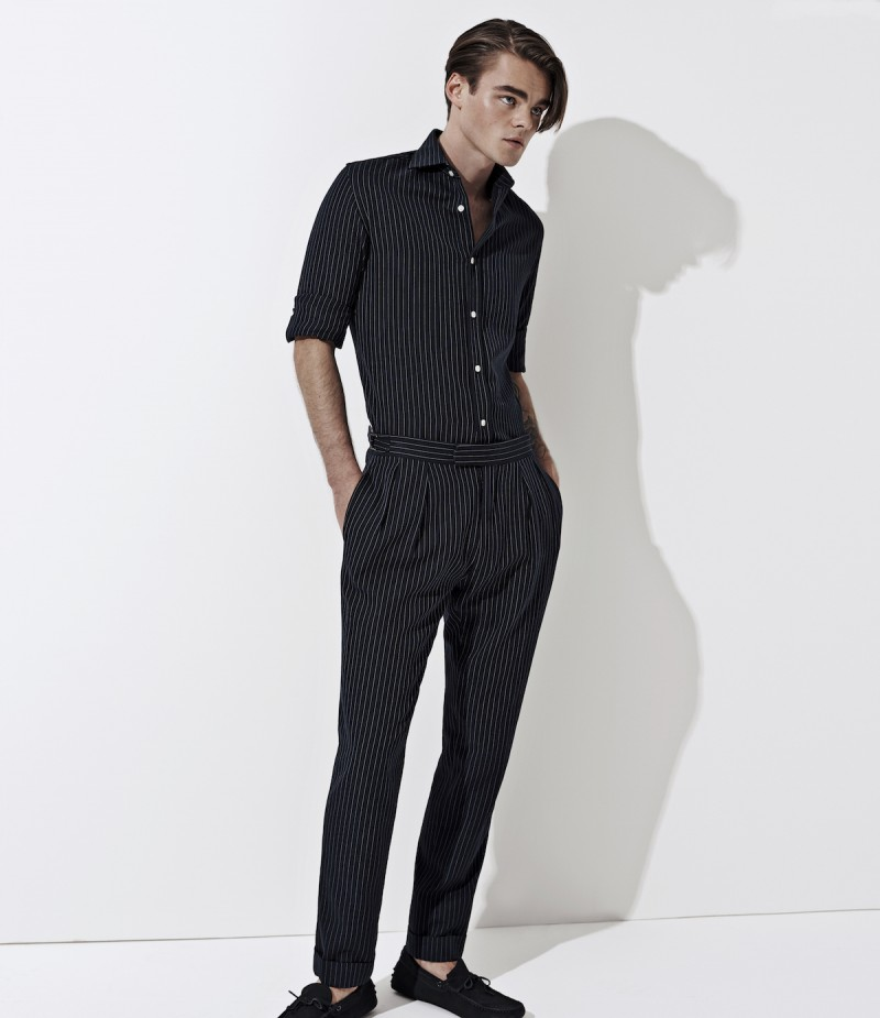 Konrad Annerud is a sleek figure in black menswear from Ralph Lauren Purple Label.