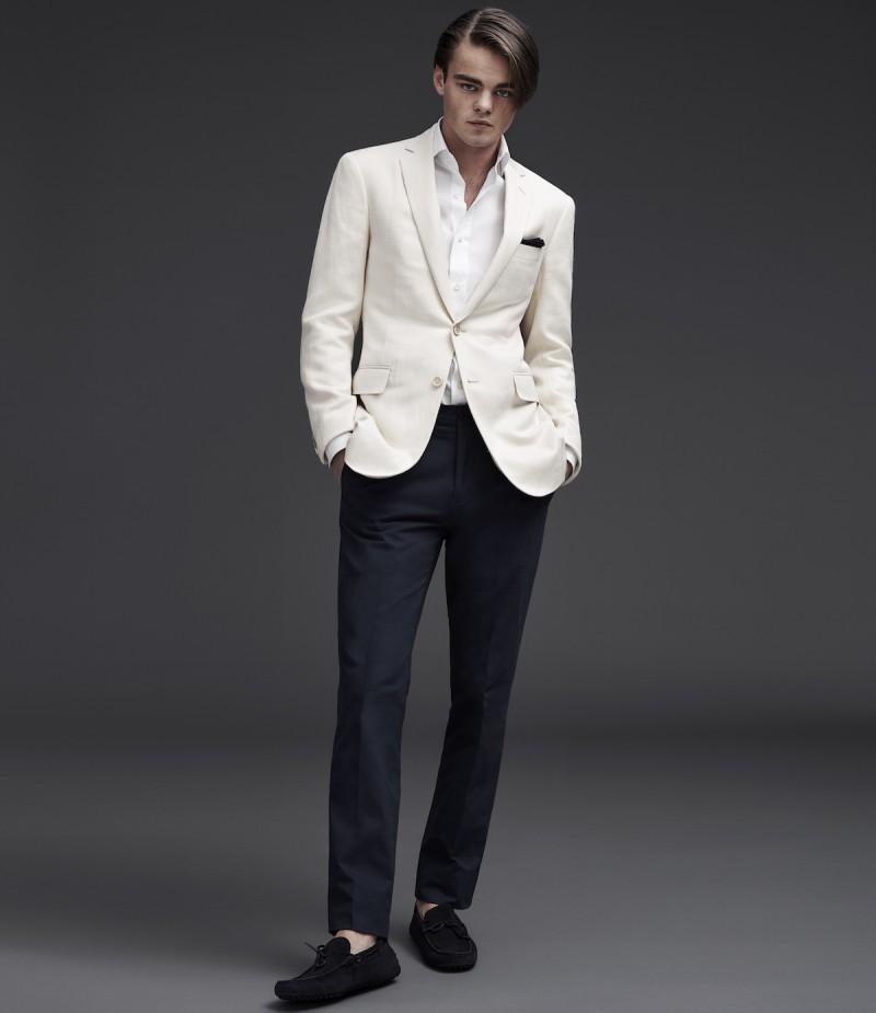 Konrad Annerud is dashing in a white jacket from Ralph Lauren Purple Label.