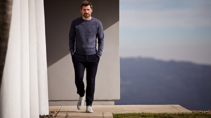 Nikolaj Coster-Waldau wears sweatshirt Tom Ford, trousers Berluti and sneakers Common Projects.