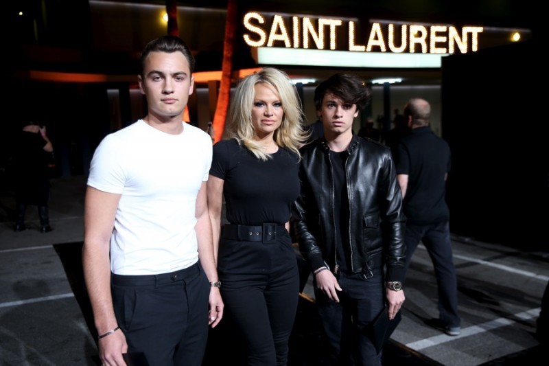 Pamela Anderson with her sons Brand and Dylan Lee at Saint Laurent's fall-winter 2016 show in Los Angeles, California.
