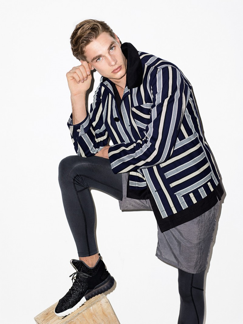 Going sporty in leggings and Tiger of Sweden shorts, Tommy Marr completes his look with a stripe jacket from Acne Studios.