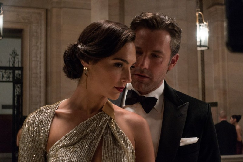 Wearing Gucci, Ben Affleck is Bruce Wayne in Batman v Superman: Dawn of Justice, posing with Gal Gadot as Diana Prince, aka Wonder Woman.