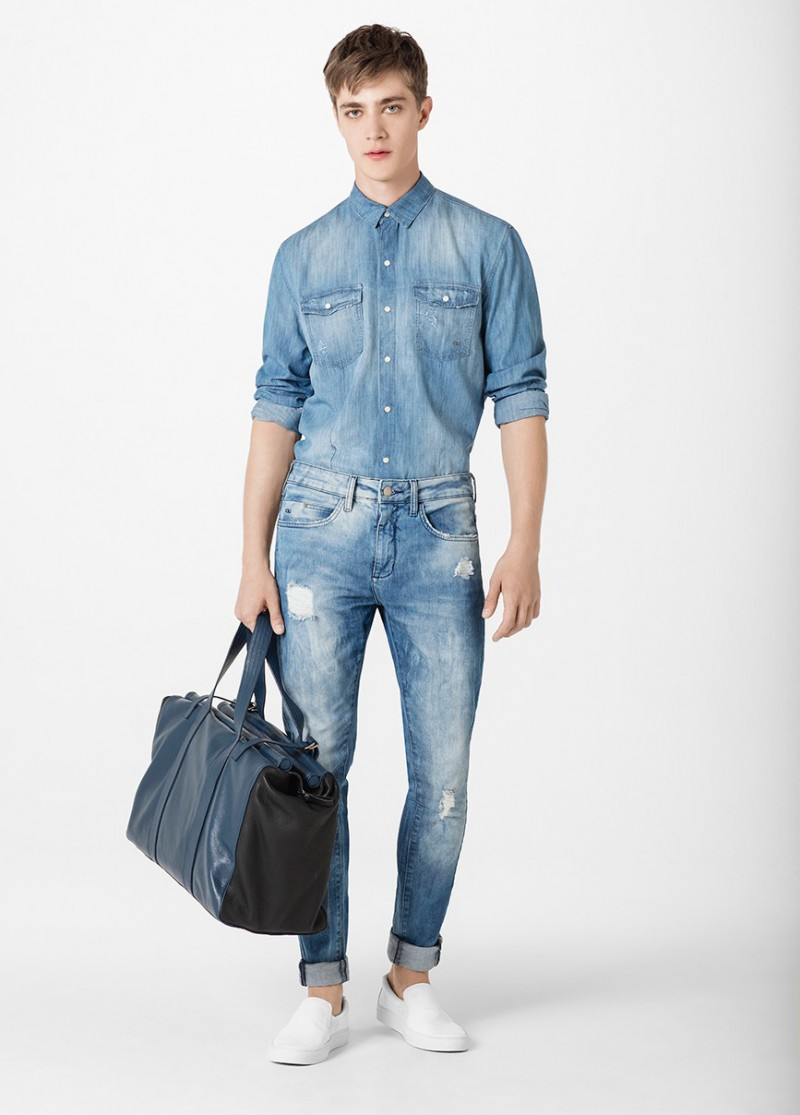 Pedro Bertolini doubles down on denim in a fitted shirt and distressed jeans.